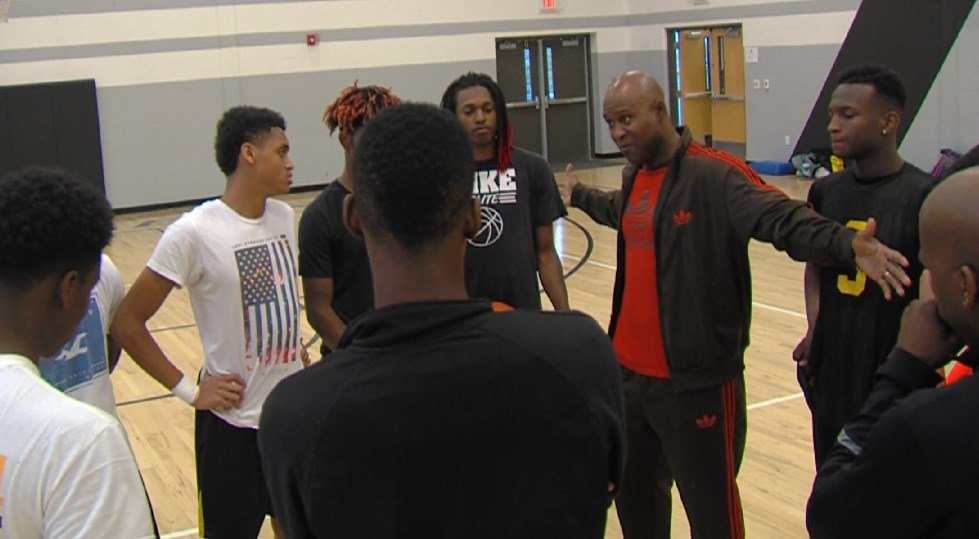 Eisenhower coach Rodney Walker meets with his team a day before their 3A regional matchup against Southeast.
