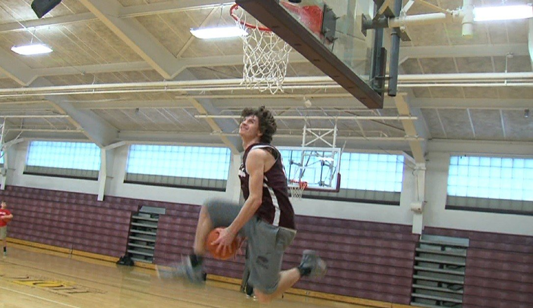 Matt Chastain leaps for his under-the-legs windmill dunk in a pre-practice slam dunk contest Wednesday.