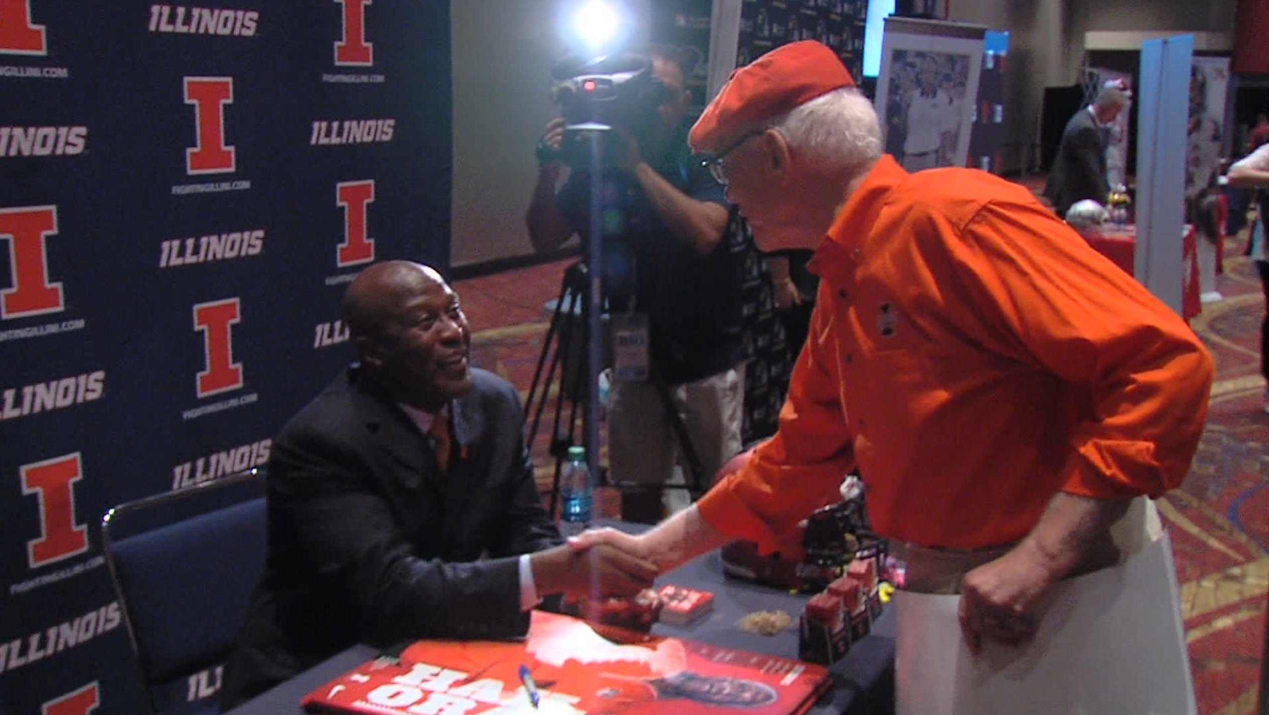 Lovie Smith greets a fan at Big Ten Media Day
