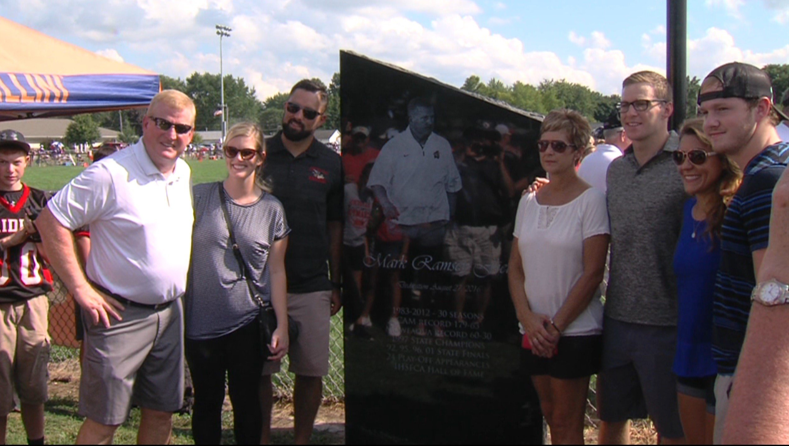 Mark Ramsey poses with family in front of new field marker