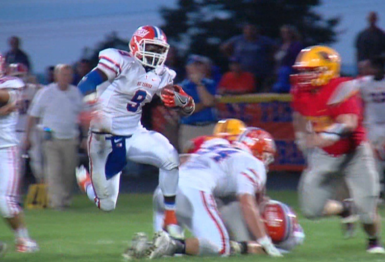 St. Teresa sophomore running back Jacardia Wright busts through the Warrensburg-Latham defense on Friday night in a rout over the Cardinals.