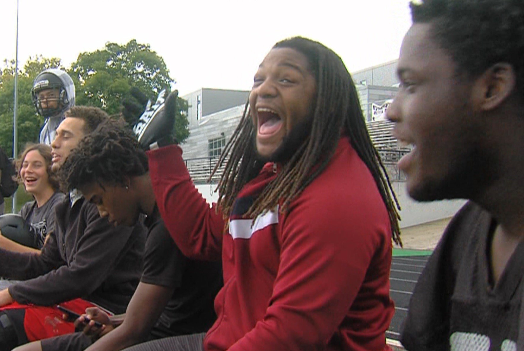Senior running back/defensive lineman Drew Thaxton and his teammates enjoy a laugh on Thursday at practice.