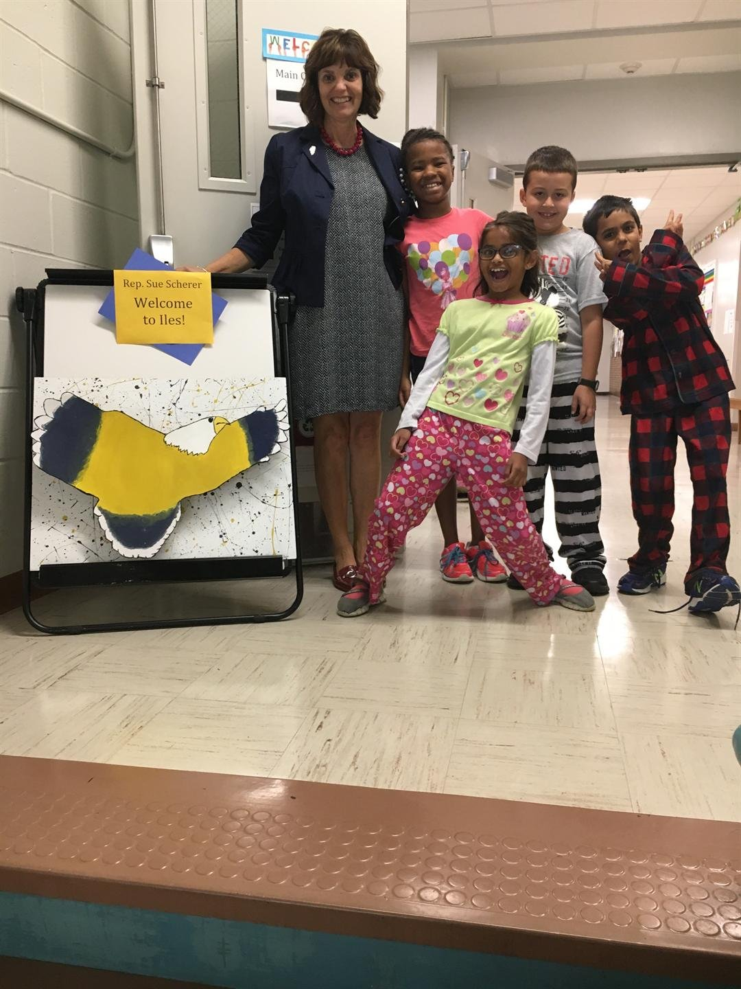 Sue Scherer with students on Pajama Day