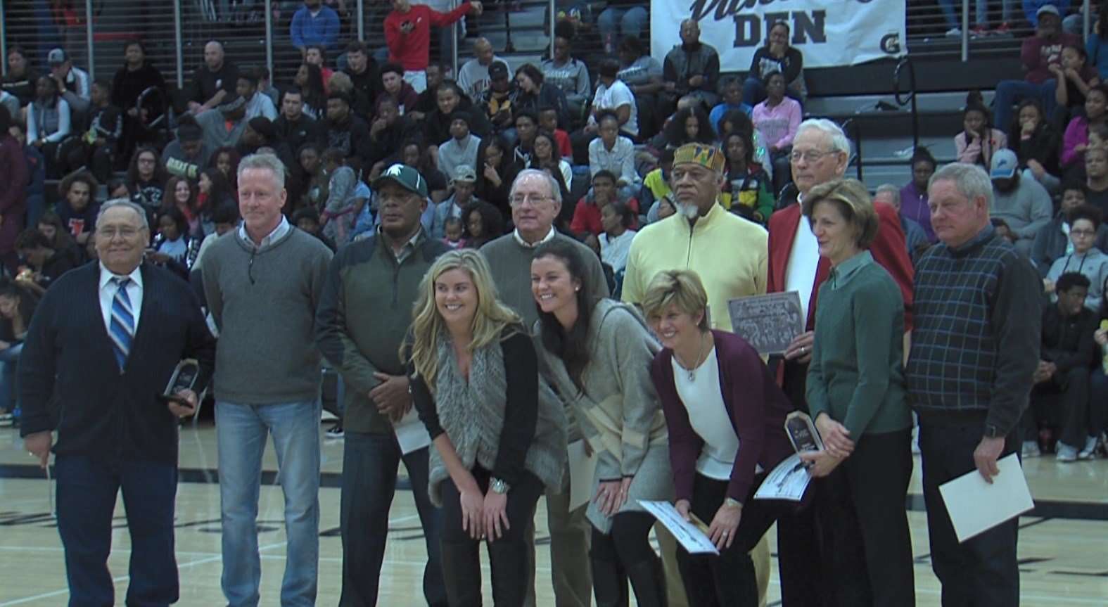 Members of the January 2017 induction class to the DPS Hall of Fame are honored during halftime of the Eisenhower-MacArthur basketball game on Friday.
