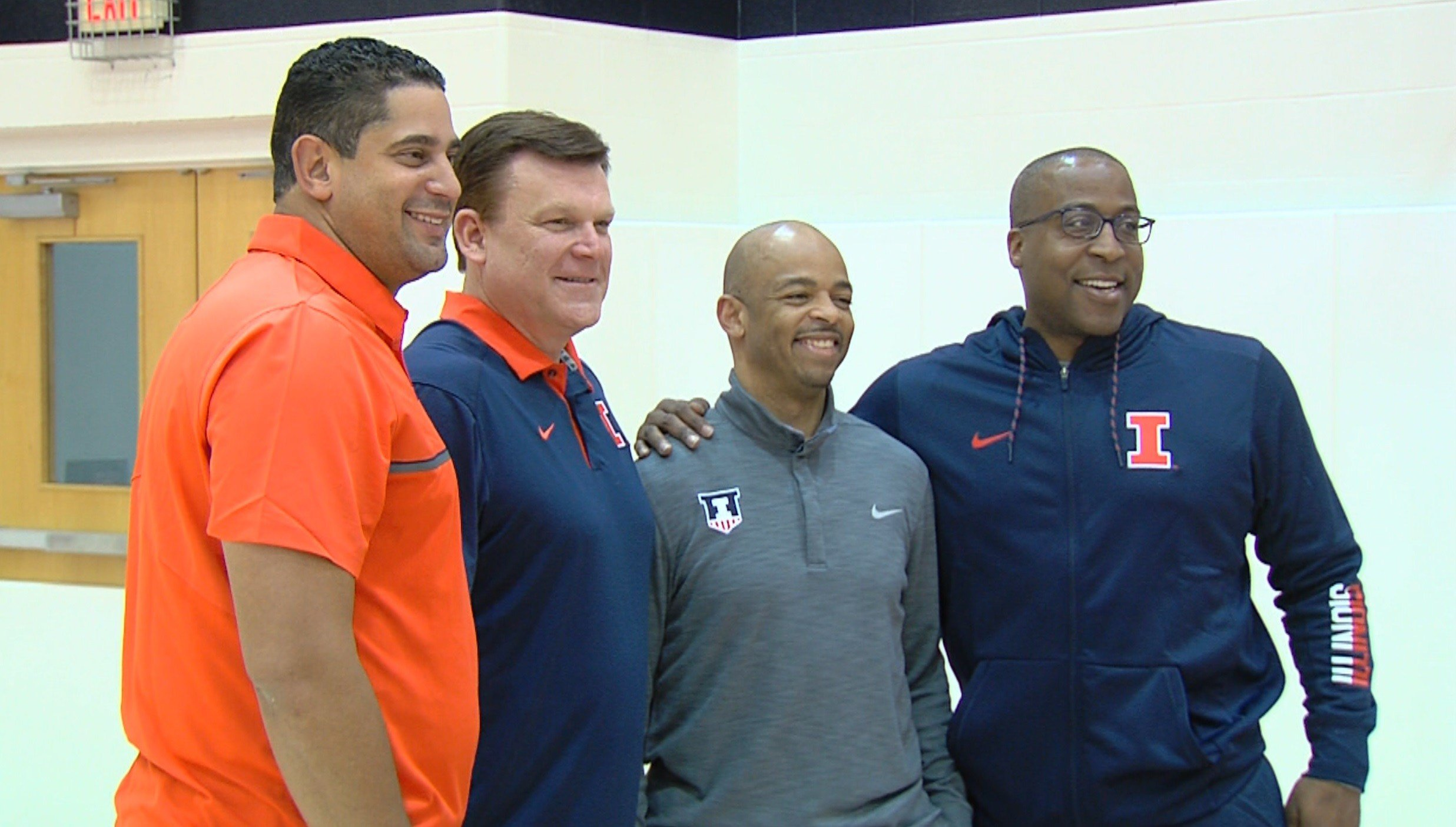 Illinois coaches Orlando Antigua, Brad Underwood, Jamall Walker and Chin Coleman (left to right) pose on Tuesday afternoon at the Ubben Basketball Complex on campus.