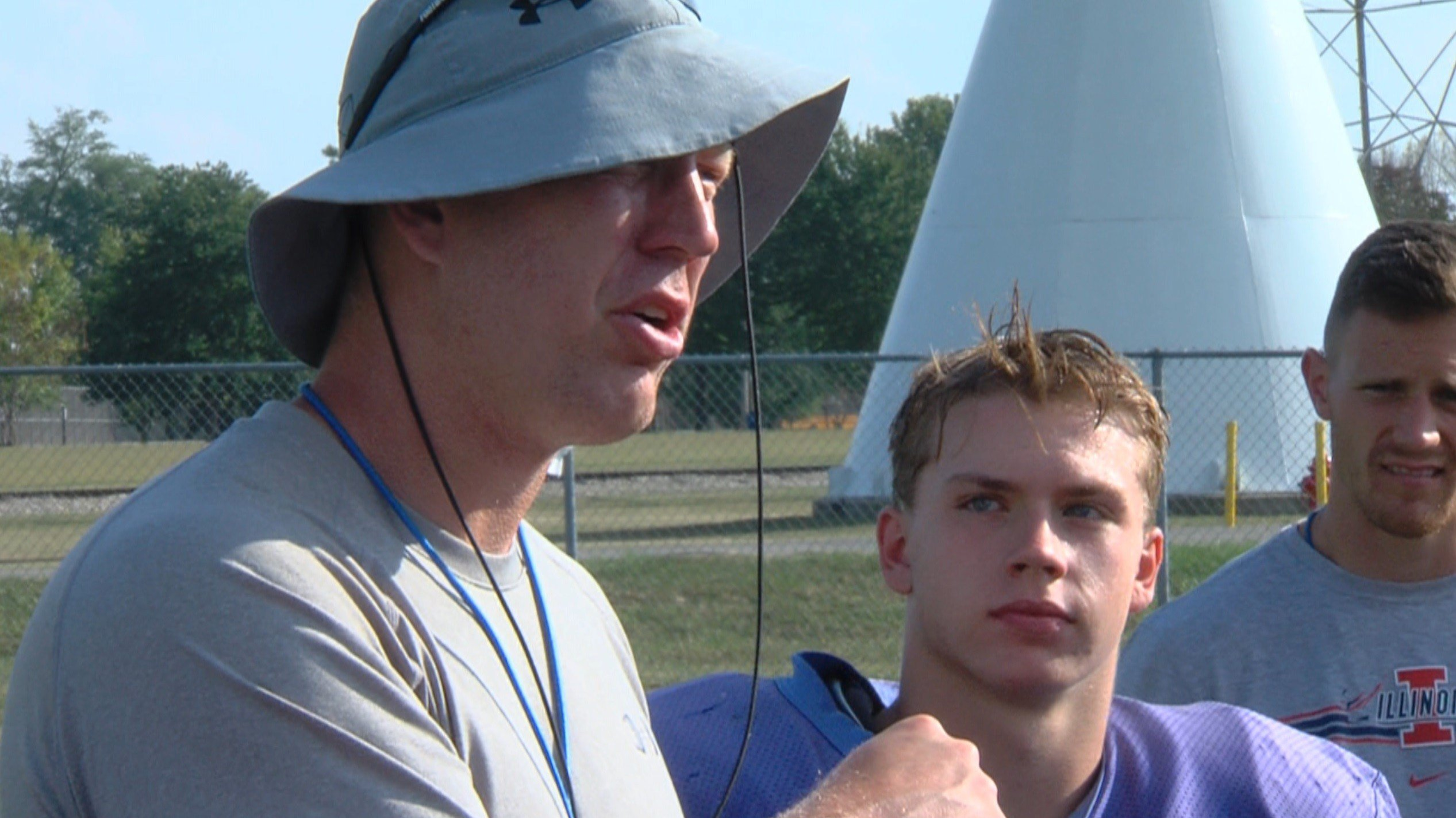 """Argenta-Oreana's Steve Kirk and the Bombers take turns giving compliments to sophomore quarterback Josh Williams on Tuesday as a part of their daily tradition the """"Bomber Drill""""."""