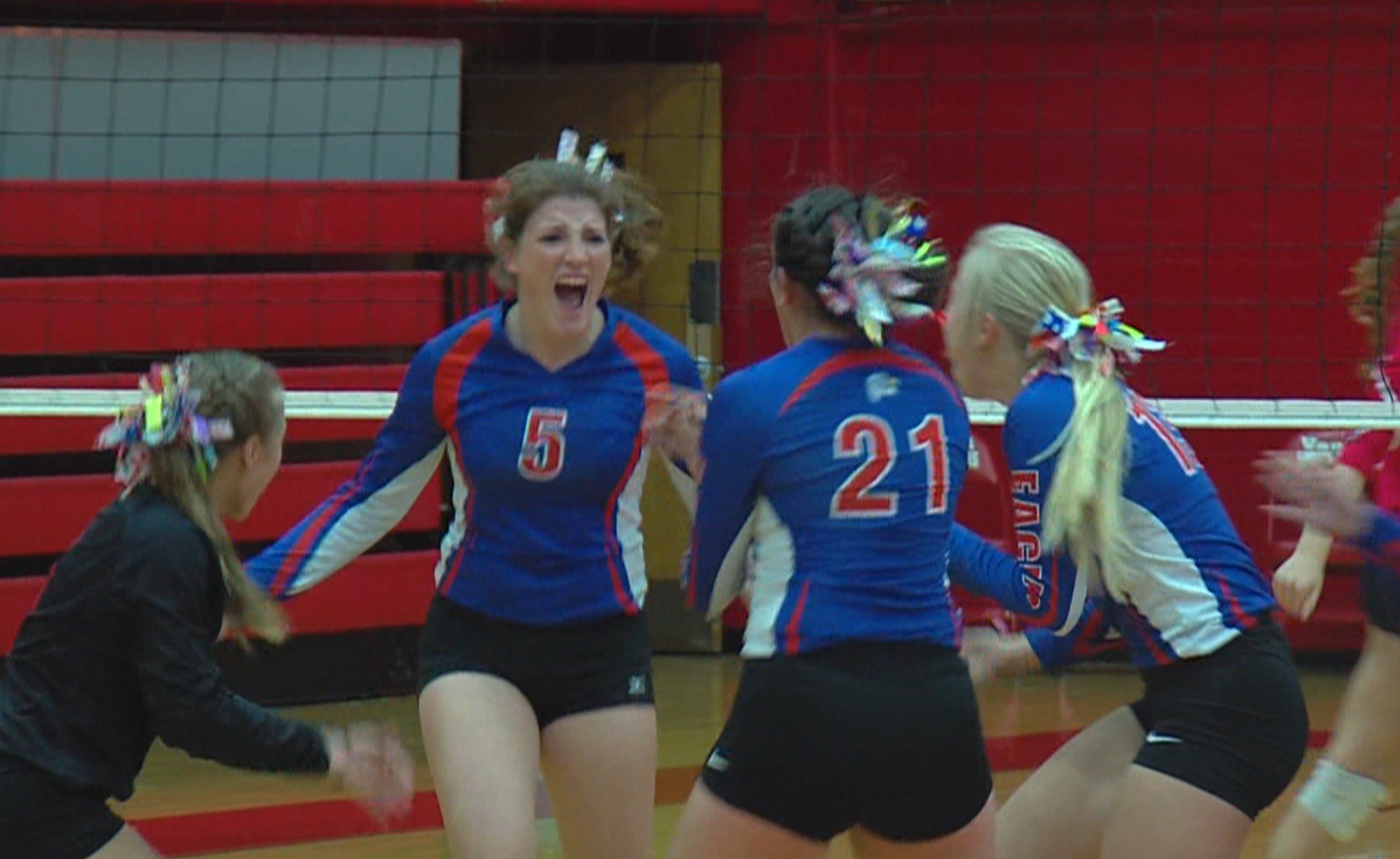 Newton's Renee Probst celebrates with her Eagle teammates in the first game of Friday night's Super-Sectional showdown with Carlinville.