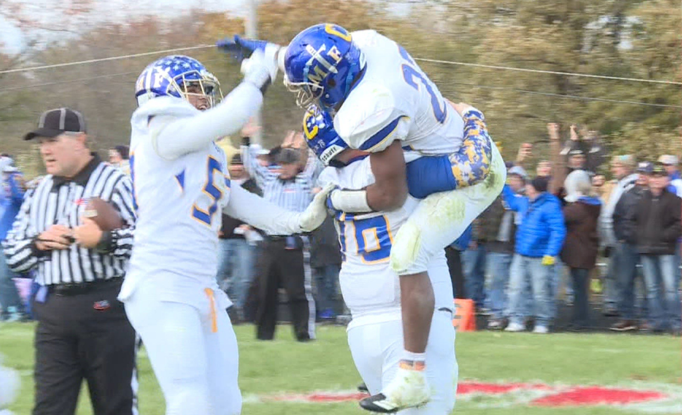 Deondre Gregory (right) and Maroa-Forsyth celebrate a come-from-behind 20-16 win over previously unbeaten West Hancock on Saturday in Hamilton.
