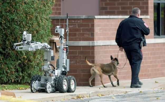 Photo courtesy of The News-Gazette (Object on the left is a robot used by the Explosive Ordinance Disposal Unit)