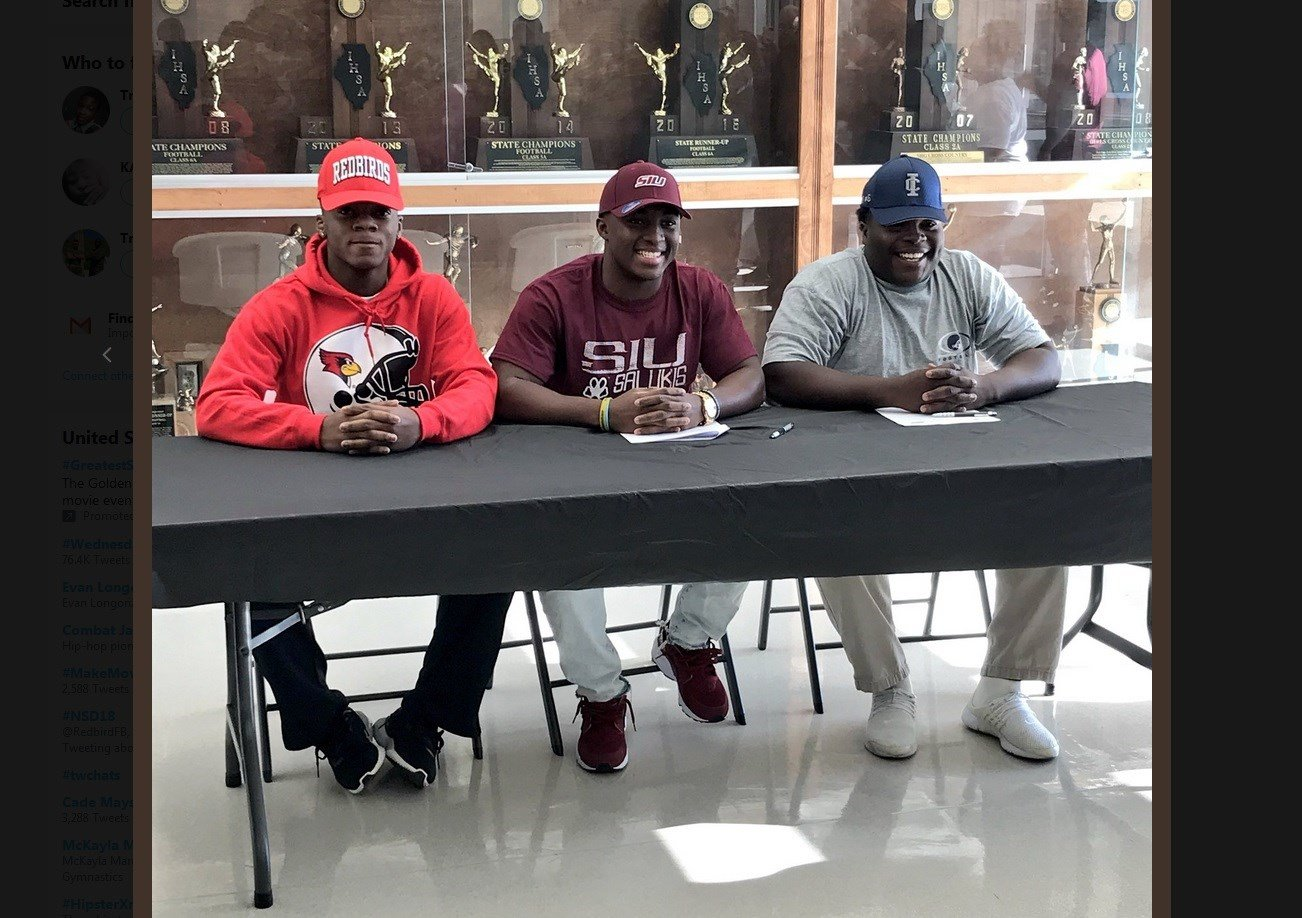 Sacred Heart-Griffin seniors Brian Adams (left, Illinois State), Tremayne Lee (Southern Illinois) and RJ Gippleh (Illinois College) sign with their respective colleges on Wednesday in Springfield. (photo: Spencer Redd)
