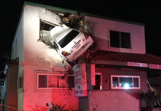 Vehicle flies into second floor of building