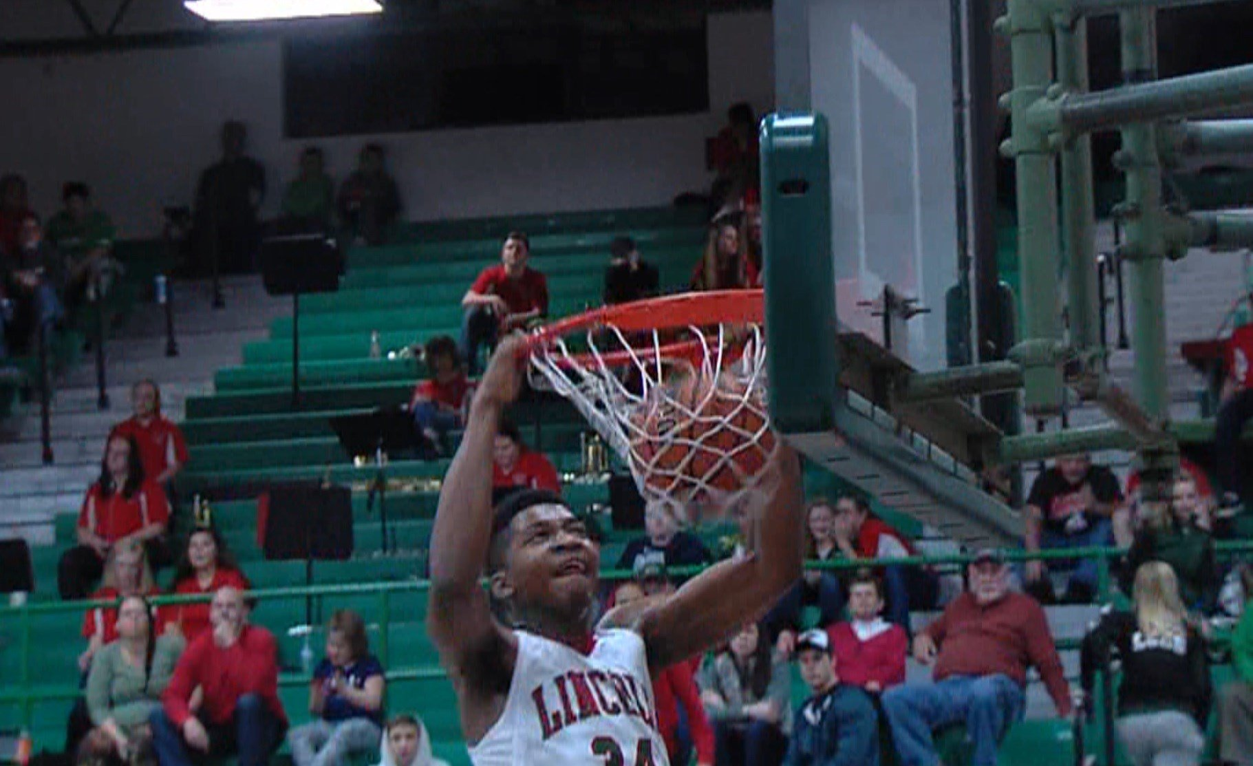 Lincoln's Jermaine Hamlin sends in a dunk on Saturday night as the Railers race past Morton 45-29.