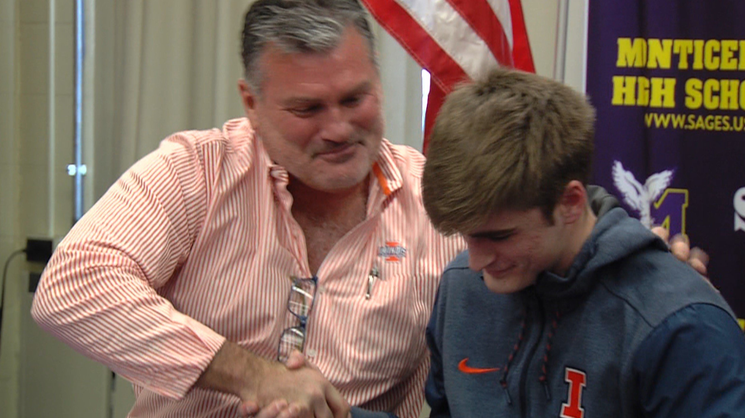 Monticello's Dylan Thomas gets congratulated by his father after signing with Illinois on Wednesday.