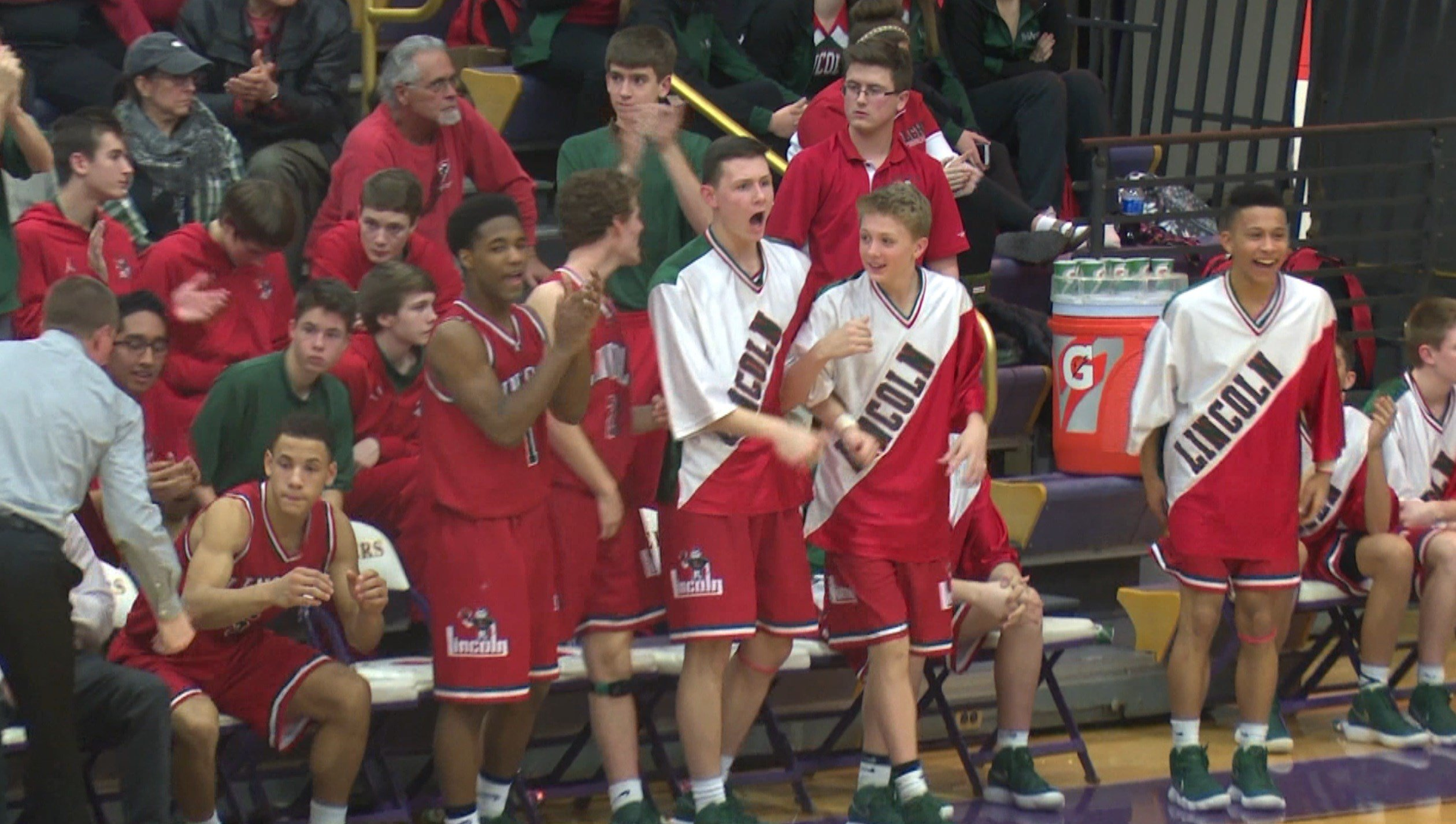 Lincoln's bench cheers on the Railers as they take down No. 8 Bloomington (4A) on the road 53-45.