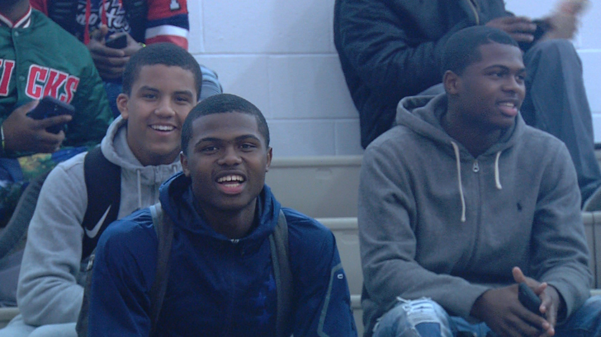 Twins Armon (middle) and Amir Brummett (right) will be apart for the first time in their lives next year when they are playing for Bradley and Northern Illinois.