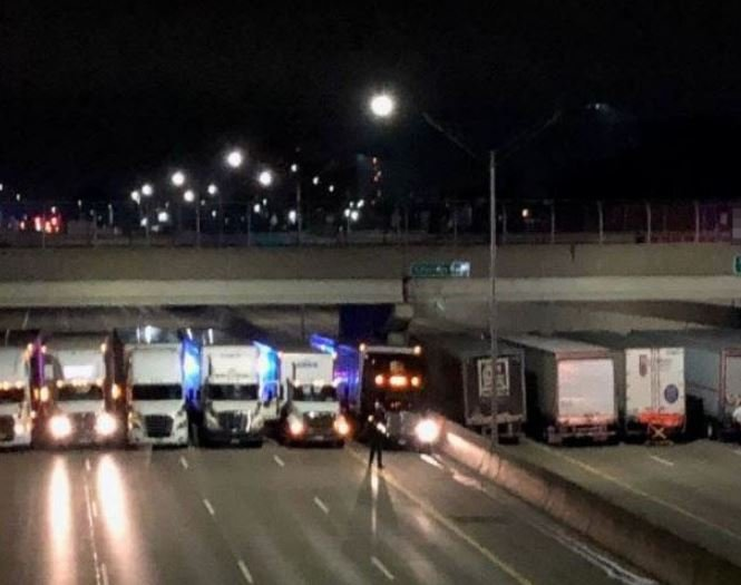 13 semis help police in MI  prevent suicidal man from jumping