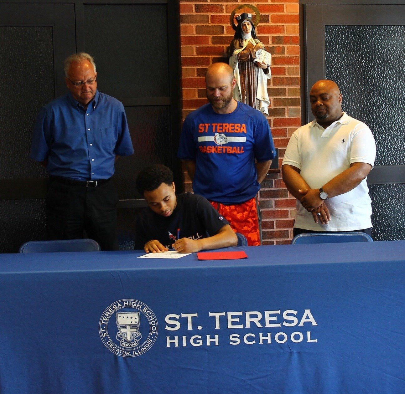 Manny Green signs with MacMurray College's basketball program on Thursday morning at St. Teresa High School. (photo: St. Teresa)