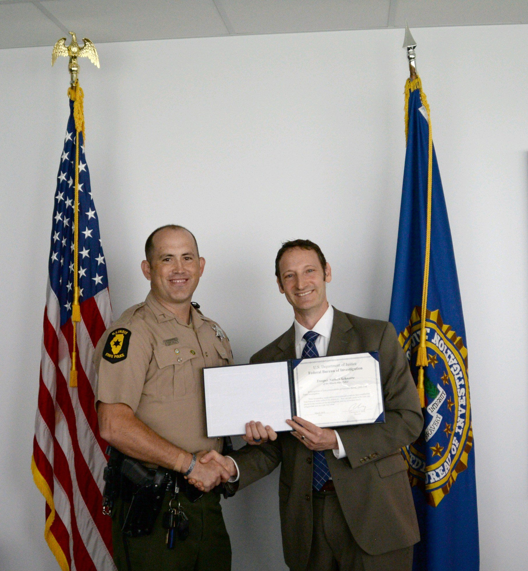 Pictured: Trooper Nathan Schnarre with FBI Asst. Special Agent in Charge Jay Greenberg