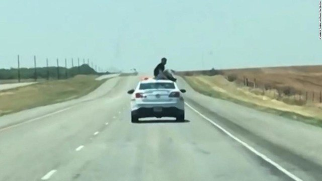 Texas inmate being transferred gets atop moving patrol car
