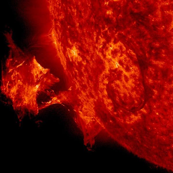 An eruption of plasma from a coronal mass ejection on Sept. 26, 2014. Charged particles like these, if directed towards Earth, can impact communication and navigation devices as well as our planet's power grids.
