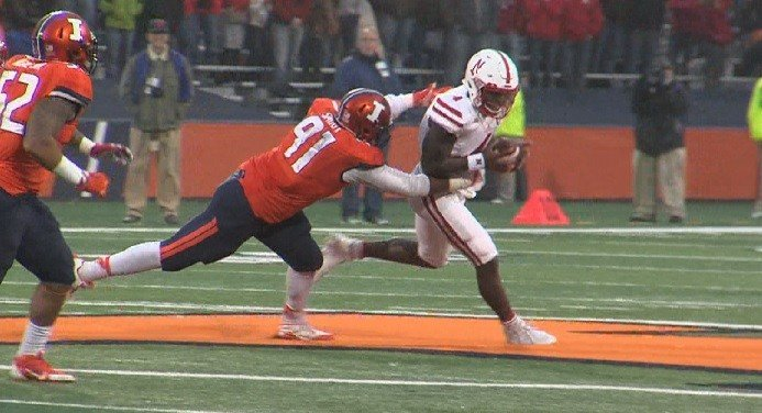Illinois' DJ Smoot (91) chases down Nebraska QB Tommy Armtrong, Jr. for a sack.