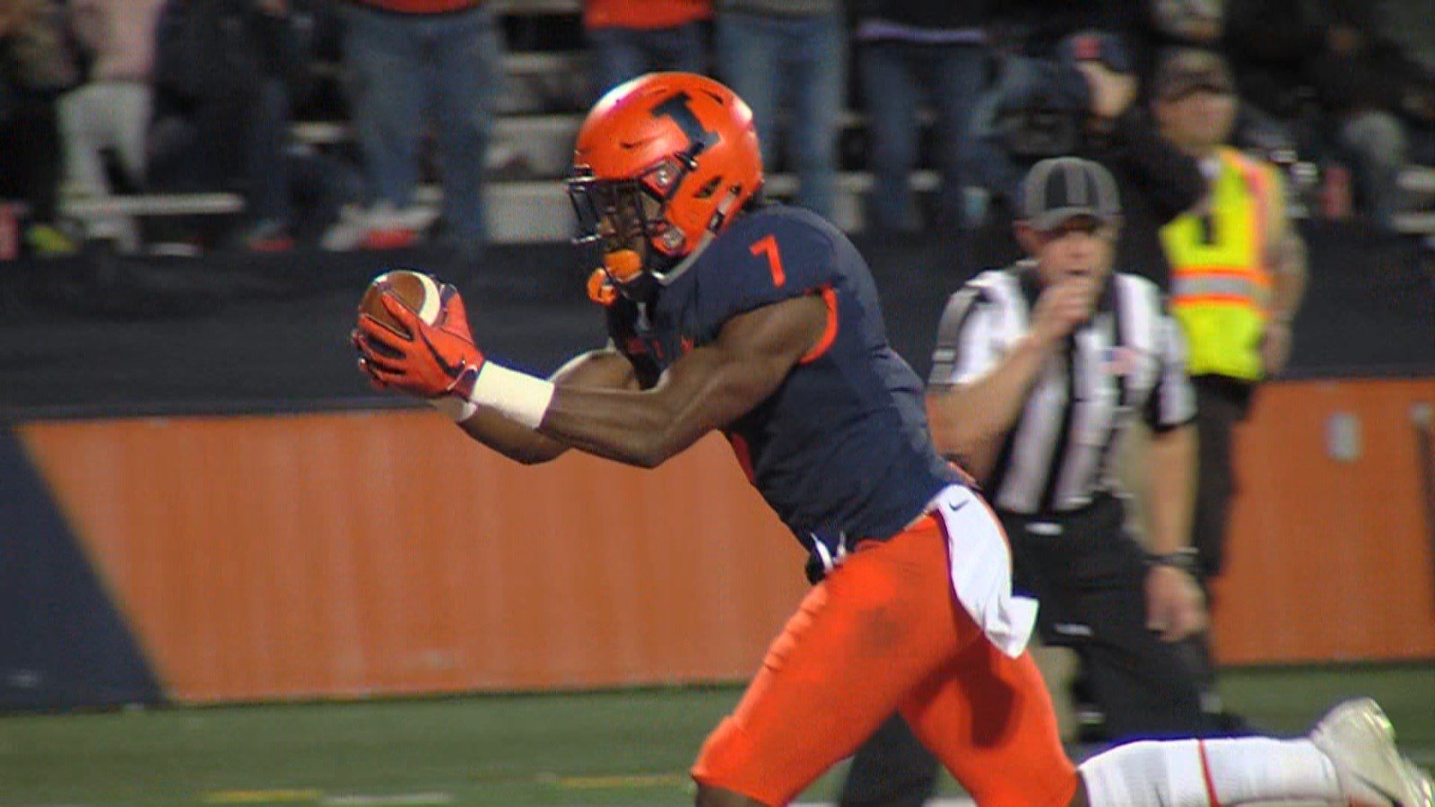 Junior safety Stanley Green scores a touchdown in the third quarter of Saturday night's win over Western Illinois. He scooped up a blocked punt (swatted by Dawson DeGroot) and helped give the Illini a 24-7 lead.