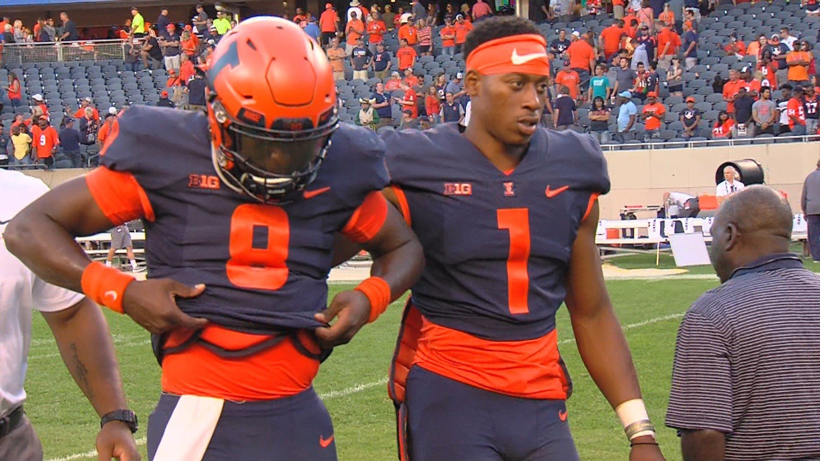 Freshman quarterback MJ RIvers (left) is consoled by graduate transfer AJ Bush moments after the Illini offense's attempt at a game-winning drive came up short on Saturday at Soldier Field.