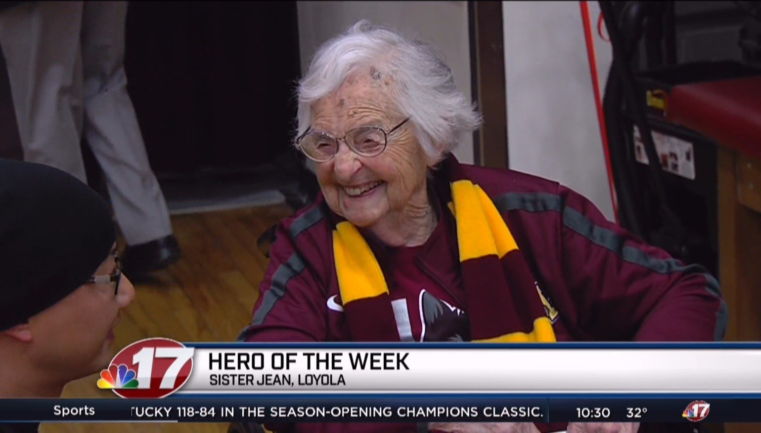 Sister Jean greets an admirer on Tuesday night before Loyola's home opener against UMKC.