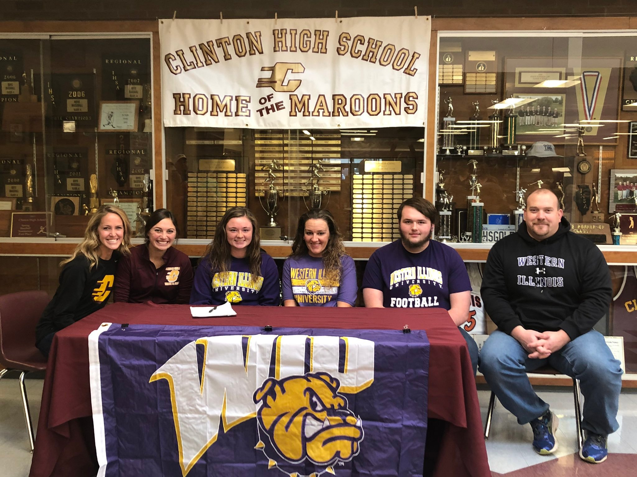 Claudia Workman signs with the Western Illinois Leatherneck track and field program on Wednesday at Clinton High School.